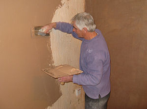 300px-Plasterer_at_work_on_a_wall_arp.jpg